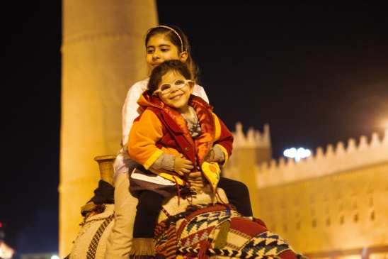 Children riding camels, Janadiriyah, Riyadh, 2014
