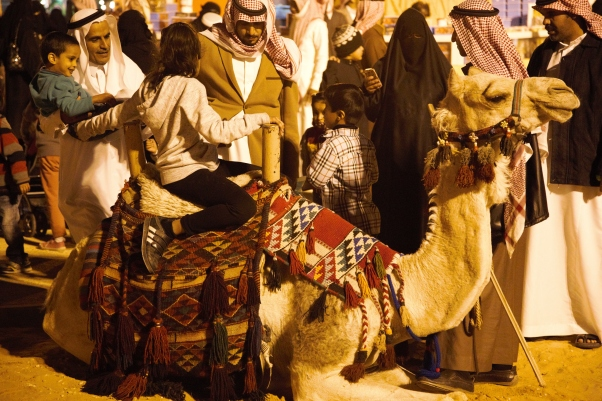 Children enjoying camel rides, Janadiriyah Festival, 2014