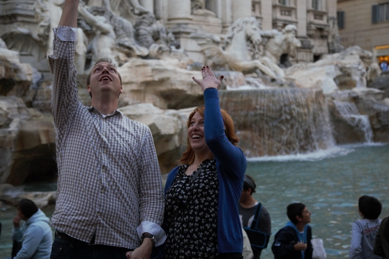 Happy couple coin toss at Trevi Fountain