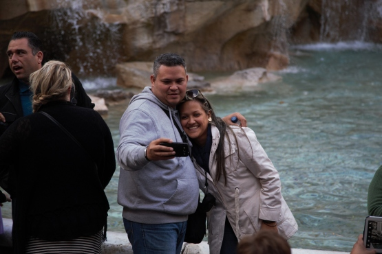 Young couple selfie at Trevi Fountain
