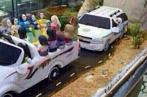 women driving cake