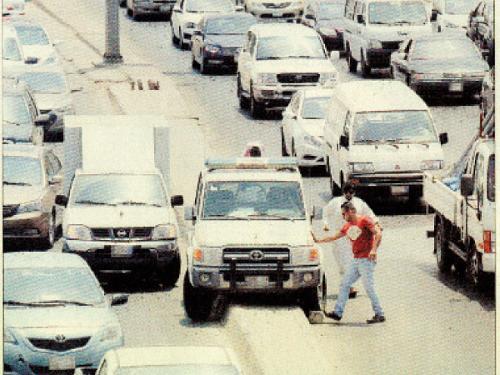 Traffic officer's car stuck on divider, Jeddah, Saudi Arabia