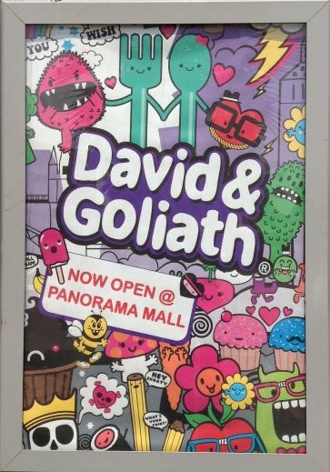 David & Goliath ad poster