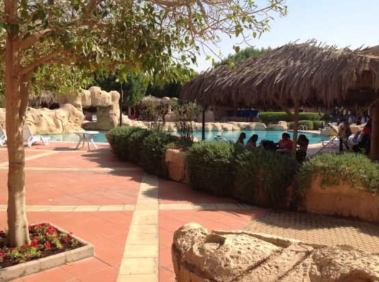 Kingdom Compound: By the pool on coffee morning