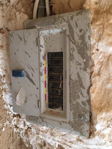 Electrical panel inside a mud brick ruin, Saudi Arabia