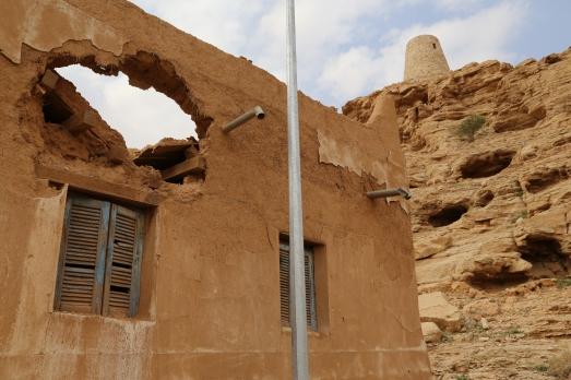 Modern fixtures in a mud brick ruin, Saudi Arabia