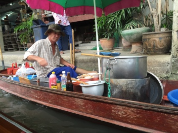 Noodle vendor at the floating market, Thailand