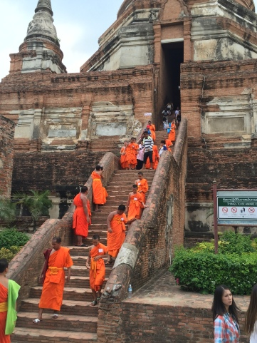 Buddhist monks along a temple staircase, Thailand