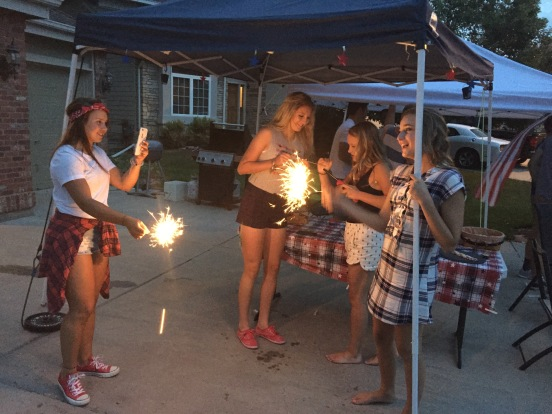 Sparklers and selfies at a neighborhood Fourth of July party
